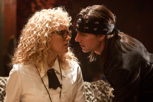 This film image released by Warner Bros. Pictures shows Malin Akerman as Constance Sack, left, and Tom Cruise as Stacee Jaxx in New Line Cinema's rock musical