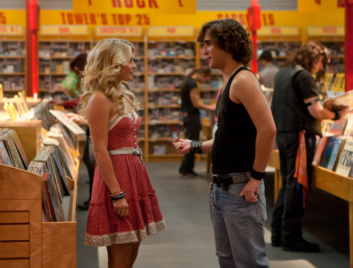 This film image released by Warner Bros. Pictures shows Julianne Hough as Sherrie Christian, left, and Diego Boneta as Drew Boley in New Line Cinema's rock musical
