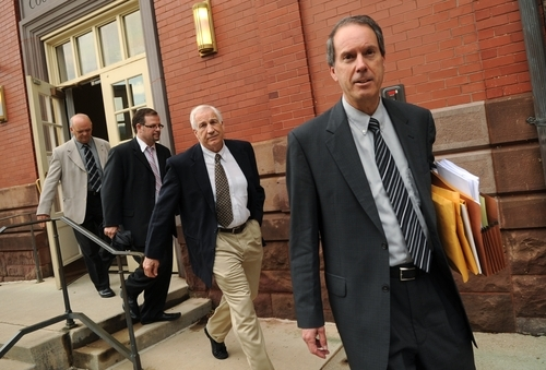 FILE - In a Tuesday, May 29, 2012 file photo, from left, Centre County Sheriff Denny Nau, attorney Karl Rominger, former Penn State assistant football coach Jerry Sandusky, and attorney Joe Amendola  leave the Centre County Courthouse Annex, in Bellefonte, Pa.,  after a closed-door meeting with the judge in Sandusky's child sexual abuse case. A simple question could be the key to the case against Jerry Sandusky: Will the young men who contend the former Penn State assistant football coach sexually abused them be viewed as credible witnesses? (AP Photo/Centre Daily Times, Nabil K. Mark, File) MANDATORY CREDIT, MAGS OUT