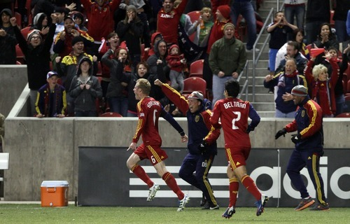 Rick Egan  | The Salt Lake Tribune   Real Salt Lake fans cheer as Nat Borchers celebrates after scoring the game winning goal, to give Real Salt Lake a 3-2 win over FC Fallas, in MLS soccer action, Real Salt Lake vs FC Dallas, in Sandy, Saturday, May 26, 2012.