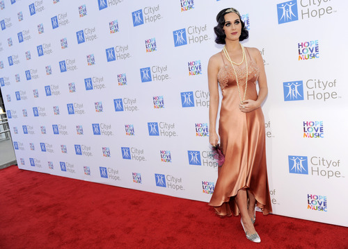 Singer Katy Perry poses at at the Spirit of Life Award Gala on Tuesday June 12, 2012 in Los Angeles.  (Photo by Chris Pizzello/Invision/AP)