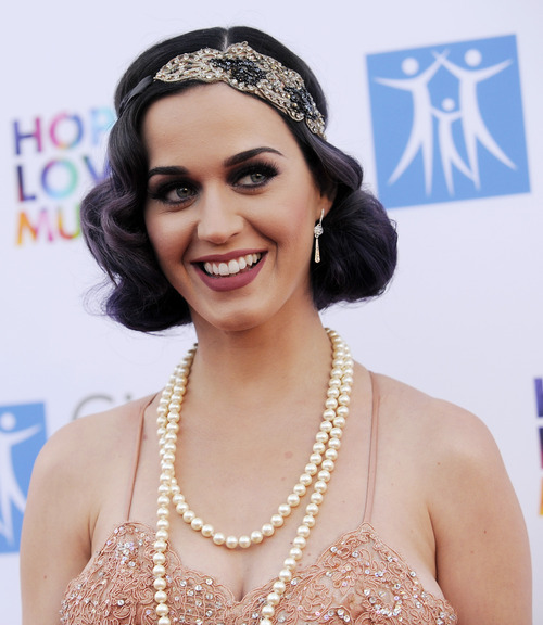 Singer Katy Perry poses at the 2012 Spirit of Life Award Gala on Tuesday June 12, 2012 in Los Angeles.  (Photo by Chris Pizzello/Invision/AP)