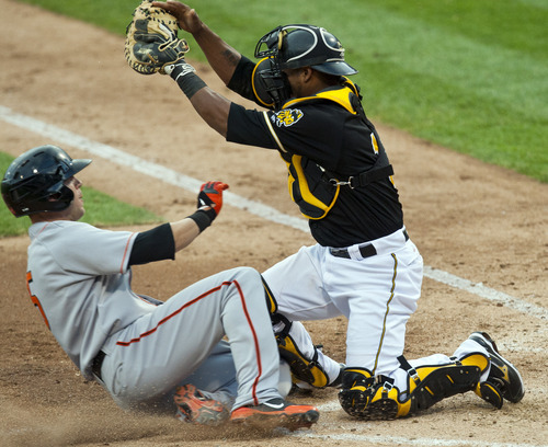 Chris Detrick  |  The Salt Lake Tribune Salt Lake Bees Alberto Rosario tags out Fresno Grizzlies Brock Bond during the game at Spring Mobile Ballpark Friday June 15, 2012.