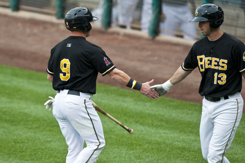 Chris Detrick  |  The Salt Lake Tribune Salt Lake Bees Kole Calhoun and Ed Lucas celebrate after Calhoun scored a RBI during the game against Fresno Grizzlies at Spring Mobile Ballpark Friday June 15, 2012.