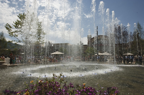Leah Hogsten  |  The Salt Lake Tribune The multimillion-dollar, 5,000-square-foot fountain that will run every hour was dedicated Friday, June 15, 2012 in Farmington.  The Station Park shopping center in Farmington unveiled a world-class show fountain with choreographed lights, music, color and 30-60-foot high dancing water.