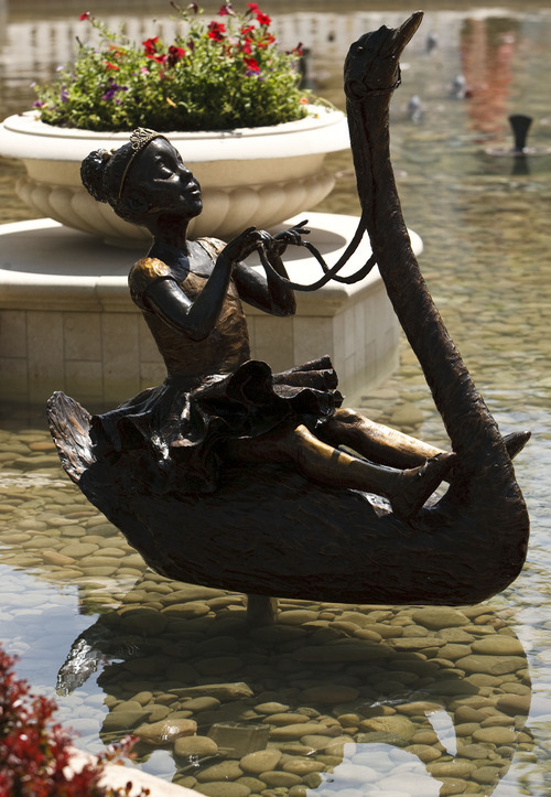 Leah Hogsten     The Salt Lake Tribune One of six bronze statues, created by sculptor Brian Keith surrounding the fountain were dedicated Friday, June 15, 2012 in Farmington.  The Station Park shopping center in Farmington unveiled a world-class show fountain with choreographed lights, music, color and 30-60-foot high dancing water.