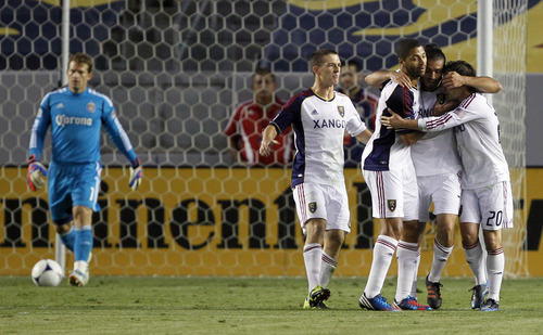 Real Salt Lake players celebrate a goal by forward Fabian Espindola, second from right, of Argentina, as Chivas USA goalkeeper Dan Kennedy, left, returns the ball for play during the first half of an MLS soccer match in Carson, Calif., Saturday, June 16, 2012. Real Salt Lake players are, from left, midfielder Will Johnson; forward Alvaro Saborio, of Costa Rica; Espindola; and midfielder Ned Grabavoy (20). (AP Photo/Alex Gallardo)