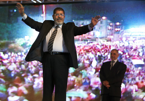 FILE - In this Sunday, May 20, 2012 file photo, the Muslim Brotherhood's presidential candidate Mohammed Morsi holds a rally in Cairo, Egypt. The Muslim Brotherhood has declared that its candidate, Mohammed Morsi, won Egypt's presidential election, early Monday, June 18, 2012.(AP Photo/Fredrik Persson, File)