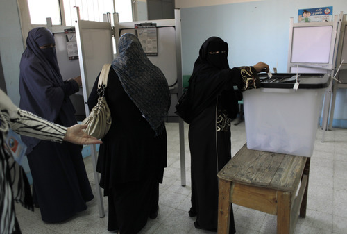 Egyptian women vote in a polling station during the first day of the presidential runoff, in Cairo, Egypt, Saturday, June 16, 2012. Egyptians voted Saturday in the country's landmark presidential runoff, choosing between Hosni Mubarak's ex-prime minister and an Islamist candidate from the Muslim Brotherhood after a race that has deeply polarized the nation. The two-day balloting will produce Egypt's first president since a popular uprising last year ousted Mubarak, who is now serving a life sentence. (AP Photo/Nasser Nasser)