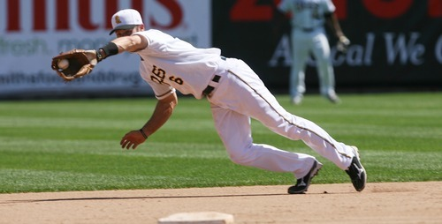 Kim Raff | The Salt Lake Tribune Salt Lake Bees player Andrew Romine dives for a ground ball during a game against the Fresno Grizzlies at Spring Mobile Ballpark in Salt Lake City on June 17, 2012.