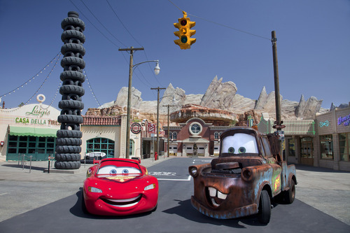This May 2012 photo released by Disneyland shows characters Lightning McQueen, left, and Mater at the new 12-acre Cars Land, a replica of Radiator Springs, the town in the popular