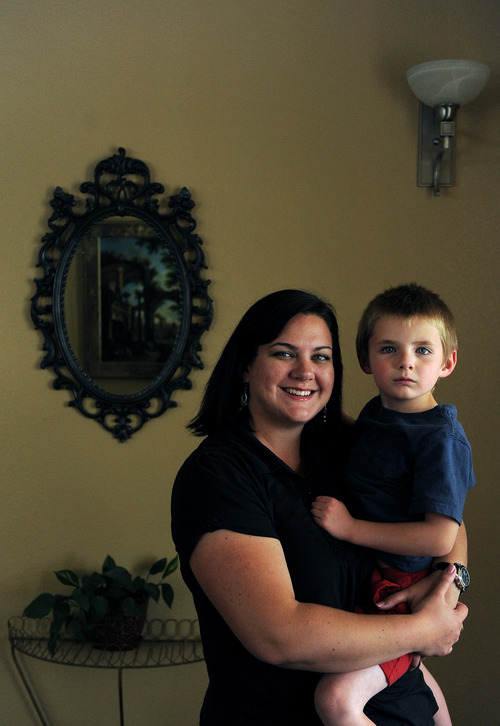 Anne Eliason and her son Isaac, 5, at their home in Highlands Ranch, Colo., on Monday, June 4, 2012. Isaac has been diagnosed with autism and his family moved from Utah to Colorado because of the insurance options and superior therapeutic and support services for Isaac. Isaac has appointments nearly everyday to work on speech, occupational and behavioral therapy. Photo by Chris Schneider