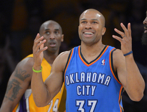 Oklahoma City Thunder guard Derek Fisher, right, reacts after being called for a foul as Los Angeles Lakers guard Kobe Bryant looks on during the second half in Game 3 of an NBA basketball playoffs Western Conference semifinal, Friday, May 18, 2012, in Los Angeles. The Lakers won 99-96. (AP Photo/Mark J. Terrill)