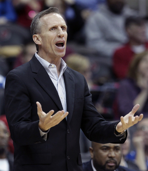 FILE-This Feb 14, 2012 file photo shows St. John's assistant coach Mike Dunlap shouting to his players during the first half of an NCAA college basketball game in Newark, N.J., Tuesday, Feb. 14, 2012.  A person familiar with the decision says the Charlotte Bobcats have hired Dunlap to be their new head coach. The person spoke on condition of anonymity Monday June 18, 2012,  because an official announcement was still being planned for the next two days. The Charlotte Observer first reported the news. (AP Photo/Mel Evans, File)