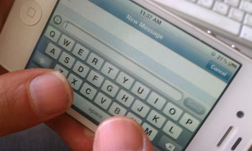 A person uses a cell phone to write a text message. Courtesy photo