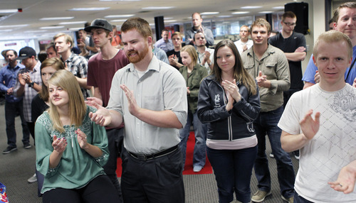 Al Hartmann  |  The Salt Lake Tribune Employees of software company Qualtrics cheer the news Tuesday that two of the world's leading venture capital firms are making an investment in the Utah tech company.