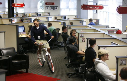 Francisco Kjolseth  |  The Salt Lake Tribune James Sukhan, an accounts manager at software company Qualtrics in Provo, rides one of several office bikes. The company which makes online survey software recently got $70 million in first round venture capital and are a hot company growing in Utah county.
