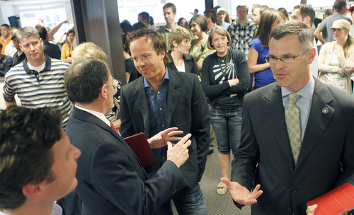 Al Hartmann  |  The Salt Lake Tribune Utah Gov. Gary Herbert, left, greets Qualtrics CEO Ryan Smith at an event Tuesday marking the company's announcement that it has closed on a $70 million round of investment funding.