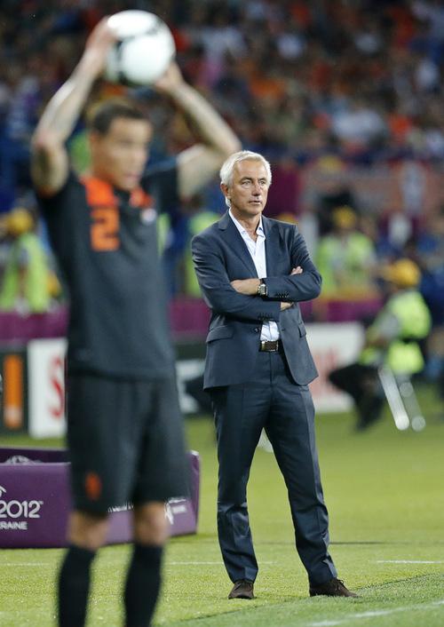 Dutch head coach Bert van Marwijk watches his team during the Euro 2012 soccer championship Group B match between Portugal and the Netherlands in Kharkiv, Ukraine, Sunday, June 17, 2012. (AP Photo/Matthias Schrader)