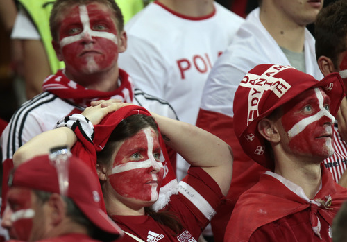 Denmark supporters react at the end of the Euro 2012 soccer championship Group B  match between Denmark and Germany in Lviv, Ukraine, Sunday, June 17, 2012.  Denmark lost 1-2. (AP Photo/Ivan Sekretarev)