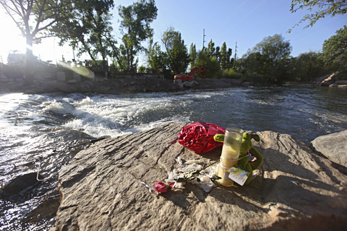 Lennie Mahler  |  The Salt Lake Tribune A memorial lies on a rock Sunday, May 13, 2012, where Corbin Anderson fell into the Weber River on April 28. Corbin's body was found downriver about a quarter mile from where he fell.