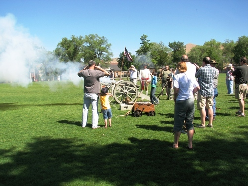 Courtesy photo Spectators watch as canons are fired on the Fort Douglas parade field in Salt Lake City on Saturday, June 16, 2012.