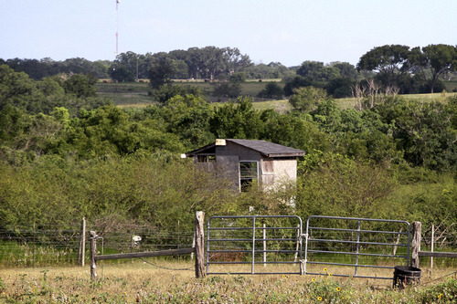 This June 16, 2012, photo shows a building near Shiner, Texas, where authorities say a Texas father beat to death with his fists a man molesting his 5-year-old daughter on June 9. A Lavaca County grand jury on Tuesday, June 19 declined to indict the father in the death of 47-year-old Jesus Mora Flores. Emergency crews found Flores' pants and underwear pulled down on his lifeless body when they responded to the 911 call.  (AP Photo/Victoria Advocate, Carolina Astrain)