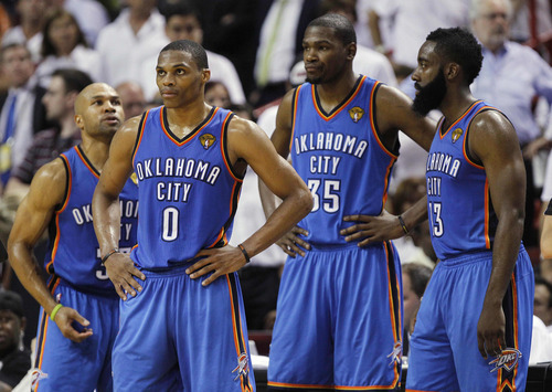 Oklahoma City Thunder players, Derek Fisher, Russell Westbrook, Kevin Durant, James Harden, from left, react at a break against the Miami Heat during the second half at Game 4 of the NBA finals basketball series, Tuesday, June 19, 2012, in Miami. The Heat won 104-98.  (AP Photo/Lynne Sladky)