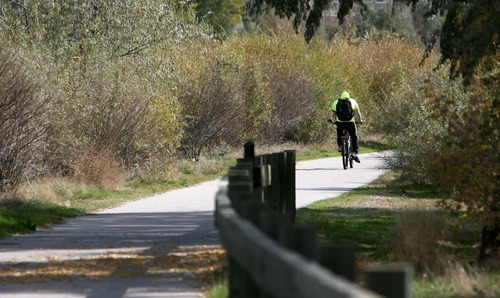 Steve Griffin  |  Tribune file photo Salt Lake County residents seem to like scenes like this: A biker making his way down a Jordan River Parkway trail near 10000 South in South Jordan.
