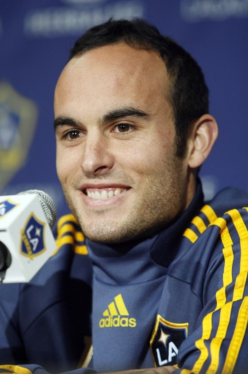Los Angeles Galaxy soccer player Landon Donovan, who recently returned from World Cup duty with the United States in South Africa, smiles during a news conference  after his first training session with his club team at Home Depot Center in Carson, Calif., Friday, July 2, 2010.  (AP Photo/Reed Saxon)
