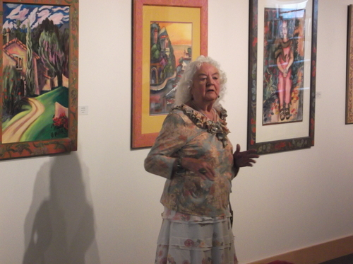 Painter Pilar Pobil talks Thursday at a reception for her Utah Arts Festival exhibit at the City Library. (photo by Sean P. Means  |  The Salt Lake Tribune)