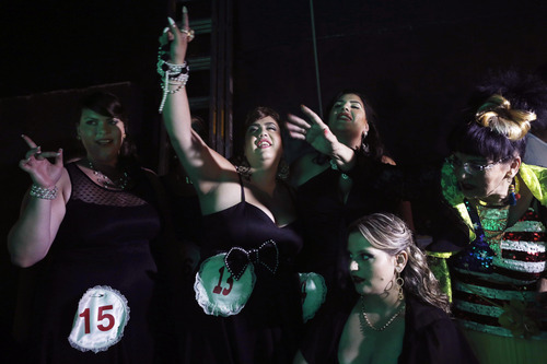 In this Monday, June 18, 2012 photo, contenders for the Israeli 2012 fat beauty queen contest, dance backstage, in the southern city of Beersheba, Israel. In order to participate, contestants are required to weigh over 80 kilograms (176 pounds). (AP Photo/Tsafrir Abayov)