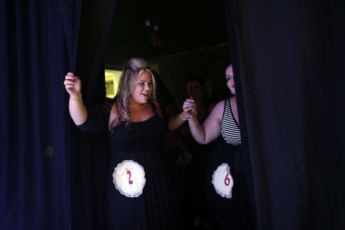 In this Monday, June 18, 2012 photo, contenders for the Israeli 2012 fat beauty queen contest, dance backstage before walking for show, in the southern city of Beersheba, Israel. In order to participate, contestants are required to weigh over 80 kilograms (176 pounds). (AP Photo/Tsafrir Abayov)