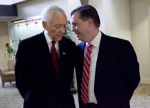 Laura Seitz  |  The Associated Press Utah Sen. Orrin Hatch and Dan Liljenquist make small talk before participating in the final debate being held before the Utah primary election. The debate took place at KSL Newsradio in Salt Lake City on Friday.