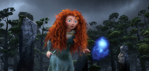 This film image released by Disney/Pixar shows the character Merida, voiced by Kelly Macdonald, following a Wisp in a scene from