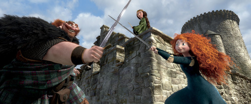 This film image released by Disney/Pixar shows characters, from left, King Fergus, voiced by Billy Connolly, Queen Elinor, voiced by Emma Thompson and Merida, voiced by Kelly Macdonald, in a scene from