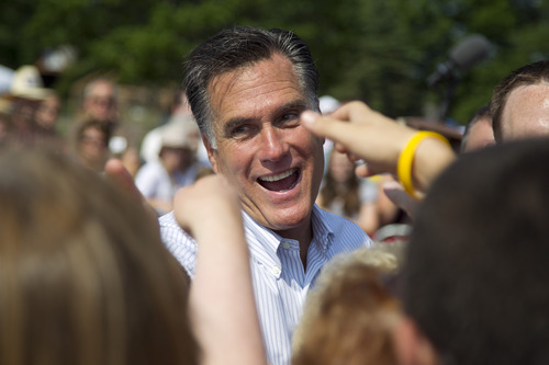 Republican presidential candidate, former Massachusetts Gov. Mitt Romney shakes hands during a campaign stop at Bavarian Inn Lodge on Tuesday, June 19, 2012 in Frankenmuth, Mich.  (AP Photo/Evan Vucci)