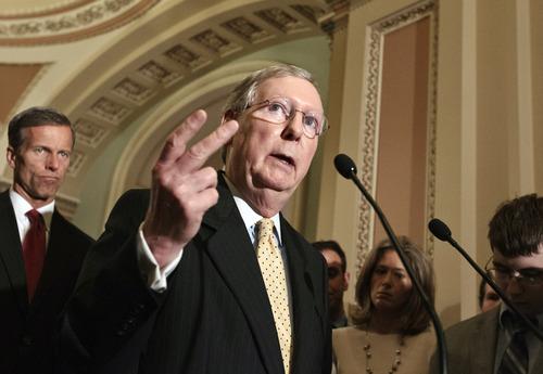 Sen. John Thune, R-S.D., left, is considered a potential running mate for Mitt Romney.  (AP Photo/J. Scott Applewhite)