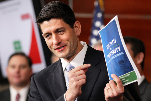 Associated Press file photo House Budget Committee Chairman Rep. Paul Ryan, R-Wis., came to Utah to promote 4th Congressional District candidate Mia Love and to attend a fundraiser for the Republican. He says she can help get control of runaway spending and debt. In this file photo, Ryan holds up a copy of his budget plan entitled