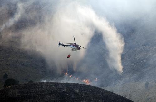 Kim Raff     The Salt Lake Tribune View of Dump Fire in Saratoga Springs-Eagle Mountain area in Saratoga Springs, Utah on June 22, 2012.