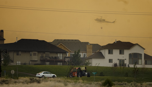 Kim Raff | The Salt Lake Tribune Helicopters are used to try and contain the Dump Fire near subdivisions in Saratoga Springs-Eagle Mountain area in Saratoga Springs, Utah on June 22, 2012.