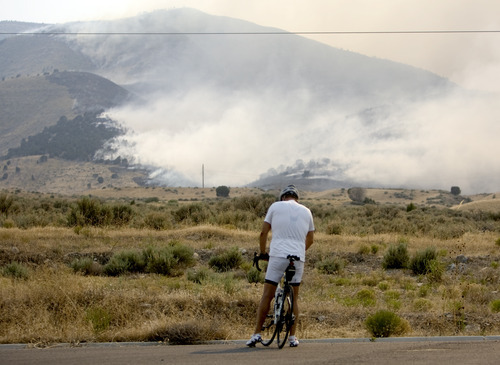 Kim Raff  |  The Salt Lake Tribune Frank Morgan watches the Dump Fire in Saratoga Springs-Eagle Mountain area in Saratoga Springs, Utah on June 22, 2012.