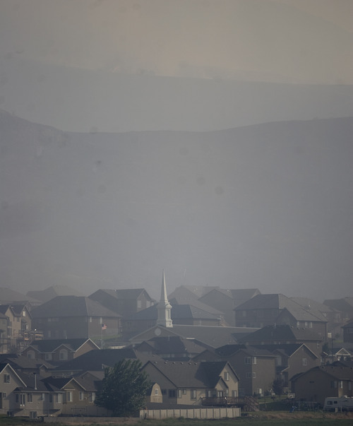 Kim Raff  |  The Salt Lake Tribune Smoke from the Dump Wildfire in Saratoga Springs-Eagle Mountain area in Saratoga Springs, Utah on June 22, 2012.