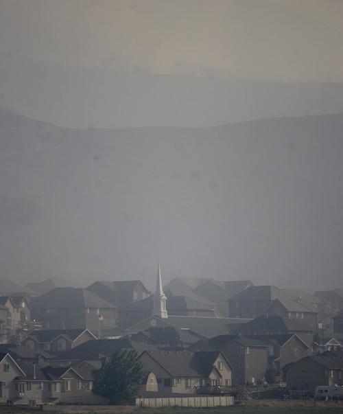 Kim Raff  |  The Salt Lake Tribune Smoke from the Dump Wildfire in Saratoga Springs-Eagle Mountain area in Saratoga Springs, Utah on June 22, 2012.