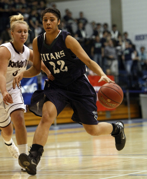 Chris Detrick  |  The Salt Lake Tribune Syracuse's Brittney Martin (22) runs past Lone Peak's Lauren Lefrandt (5) during the game at Salt Lake Community College Thursday, Feb. 23, 2012. Syracuse won the game 66-43.
