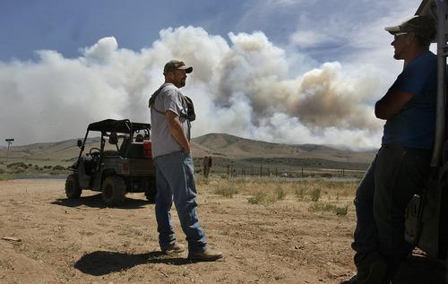 Scott Sommerdorf  |  The Salt Lake Tribune              Troy Olsen, left and Robert Lamb watch a brush fire near Fountain Green, Sunday, June 24, 2012.