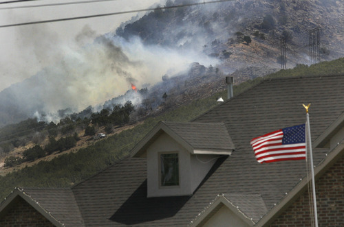 Scott Sommerdorf  |  The Salt Lake Tribune              A brush fire near Fountain Green burns near homes but as of 1 p.m. had not seriously threatened homes in town, Sunday, June 24, 2012.