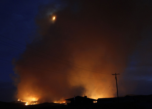 Al Hartmann  |  The Salt Lake Tribune   Farm north of Fairview is silhouetted against the backdrop of the Wood Hollow fire several miles to the west Sunday night.
