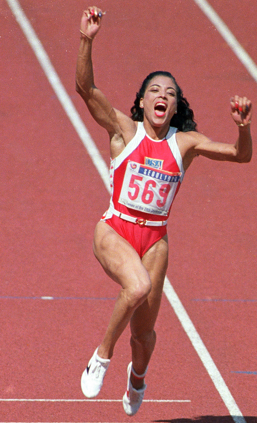 Florence Griffith Joyner celebrates winning gold in the womens 100-meter event at the Summer Games in Seoul, in this Sept. 25, 1988 photo.  (AP photo/Rusty Kennedy)