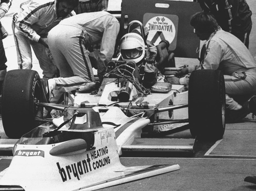 Janet Guthrie, the first woman to compete in an Indianapolis 500-mile race, is shown in her car as her pit crew works on May 29, 1977. (AP Photo)